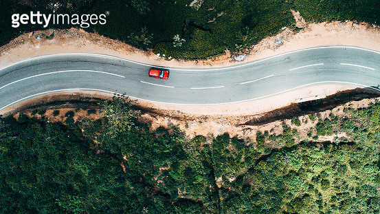 Aerial view on  red car on the road near green tea plantation in mountains in Sri Lanka - gettyimageskorea