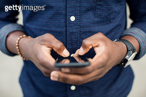Midsection of man using mobile phone - gettyimageskorea