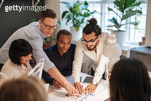 Coworkers working in modern co-working space in Scandinavia. Multi-ethnic group of young business professionals, start-up establishers, freelancers working and developing together. - gettyimageskorea