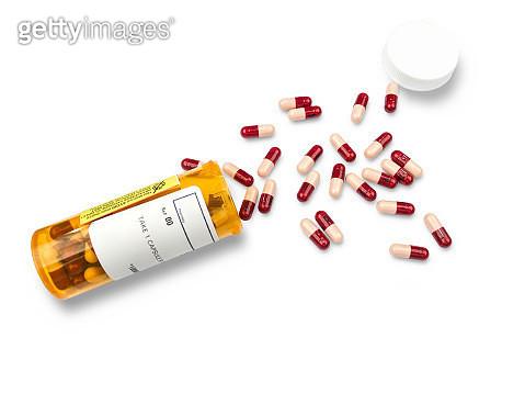 RX pharmacy prescription bottle of pills on white - gettyimageskorea