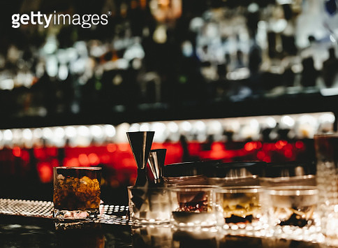 View Of Nightclub Beer Bar With Alcoholic Bottles Stacked On Shelf - gettyimageskorea