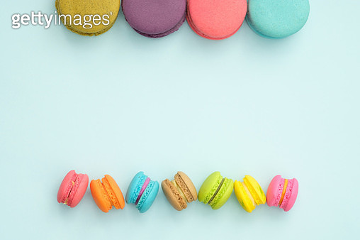 Close-Up Of Colorful Macaroons Over Blue Background - gettyimageskorea