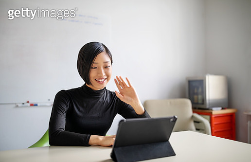 Female professional making a video call in office - gettyimageskorea