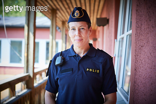Portrait of policewoman standing in balcony at police station - gettyimageskorea