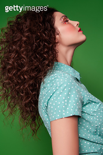 Stylish young brunette with curly hair - gettyimageskorea