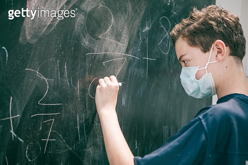 teenager boy wearing protective mask at school - gettyimageskorea