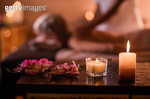 Close up of candles and flowers at the spa. - gettyimageskorea
