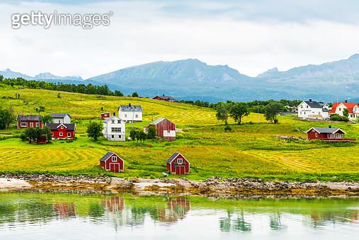 Norway, Nordland, Vestvagoey, Lofoten Island, houses at coast - gettyimageskorea