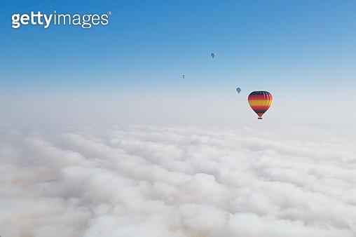 Hot air balloons over morning fog in Dubai desert. - gettyimageskorea