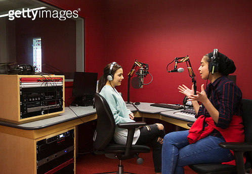 Teenage musicians recording music in sound booth - gettyimageskorea