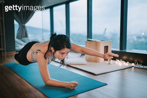 an asian chinese young teenager girl yoga workout in her room in the evening - gettyimageskorea