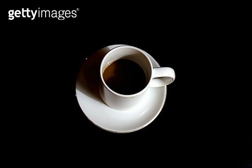 Close-Up Of Tea Cup Over Black Background - gettyimageskorea
