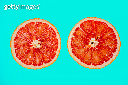 Summer vibes summer theme with grapefruit halves slices - gettyimageskorea
