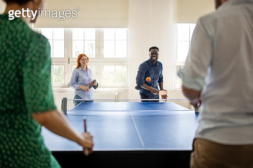 Business team enjoying playing table tennis in work break - gettyimageskorea