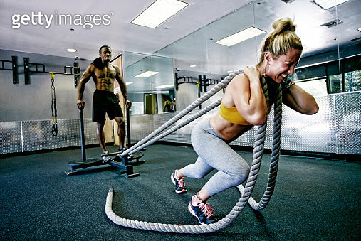 People working out with ropes in gym - gettyimageskorea