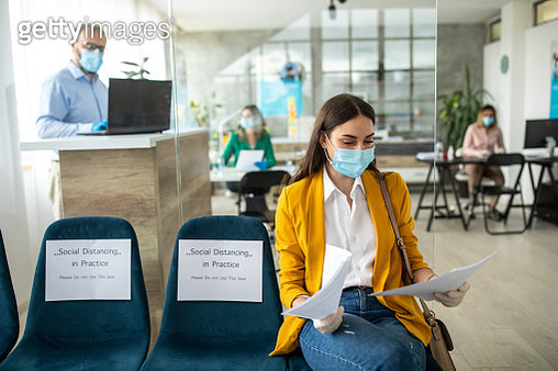 Businesswoman with face protective mask in bank waiting room - gettyimageskorea
