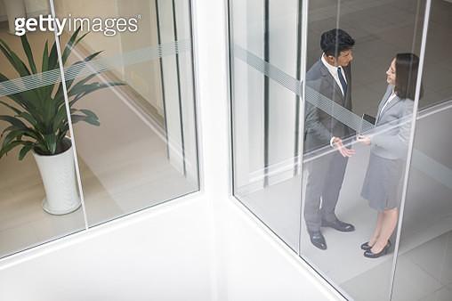 Business person talking in office - gettyimageskorea