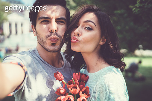 Young couple taking selfie outside - gettyimageskorea