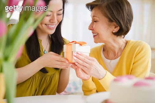 Japanese daughter giving mother gift - gettyimageskorea