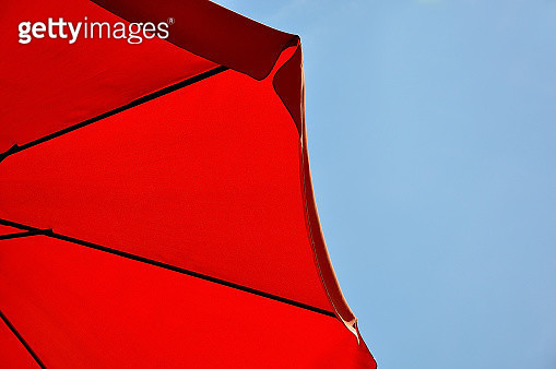 Low Angle View Of Red Umbrella Against Blue Sky - gettyimageskorea
