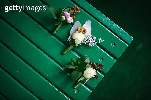 Three wedding corsages on green chair - gettyimageskorea
