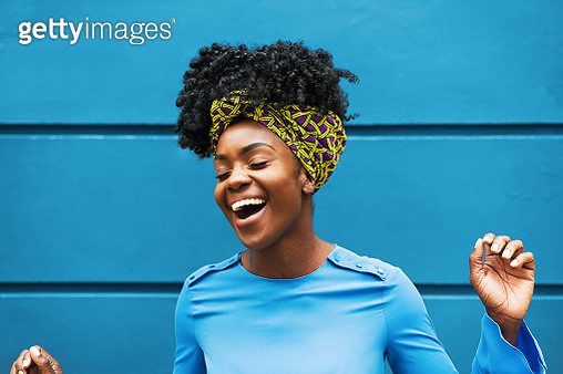 Joyous woman infront of wall - gettyimageskorea