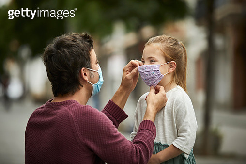 Father Putting Home Made Face Mask on Little Daughter - gettyimageskorea