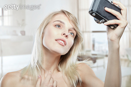 blond girl with blue eyes and clean face smiling while taking a selfie - gettyimageskorea