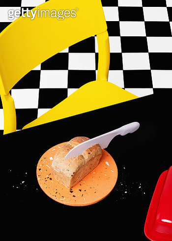Still life image of very short bread on a cutting board with knife. - gettyimageskorea
