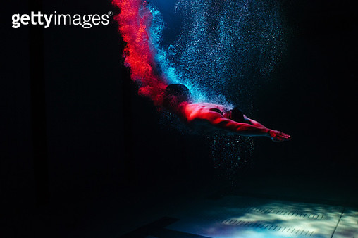Underwater shot of male downward dive into swimming pool - gettyimageskorea