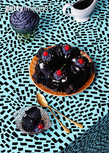 Still life image of a black jelly dessert with black cream and black sauce. - gettyimageskorea