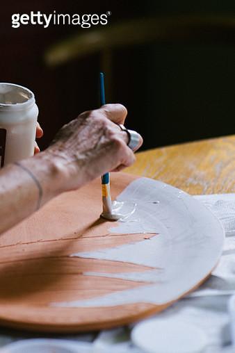 Ceramist at work - gettyimageskorea
