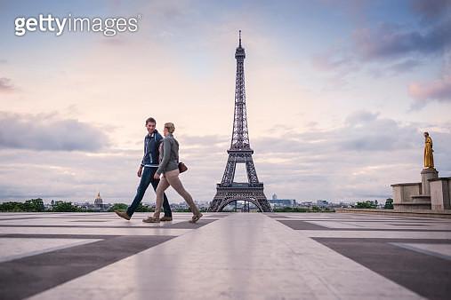 Caucasian couple walking near Eiffel Tower, Paris, France - gettyimageskorea