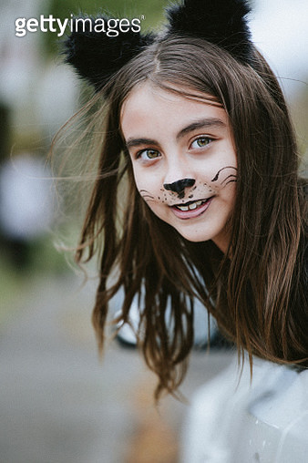 Girl in a cat's costume at Halloween - gettyimageskorea