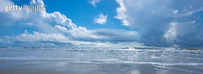 Panoramic View of Beach against a blue sky - gettyimageskorea