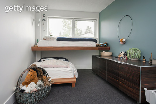 Bunk beds, dresser and stuffed animals in child - gettyimageskorea