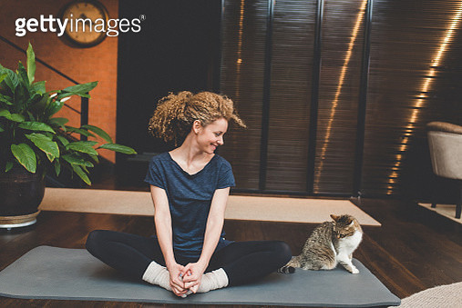 Practicing yoga at home - gettyimageskorea