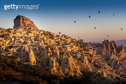 Hot air balloons flying over pigeon valley of Cappadocia, Turkey - gettyimageskorea