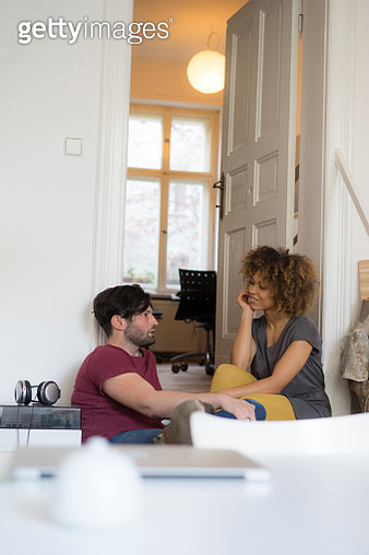Young couple at home relaxing and talking - gettyimageskorea