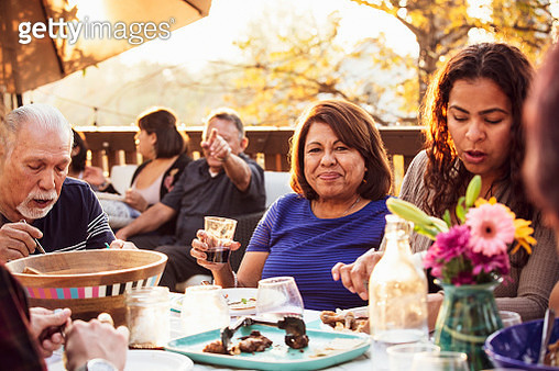 Multi-generation family enjoying outdoor dinner party - gettyimageskorea