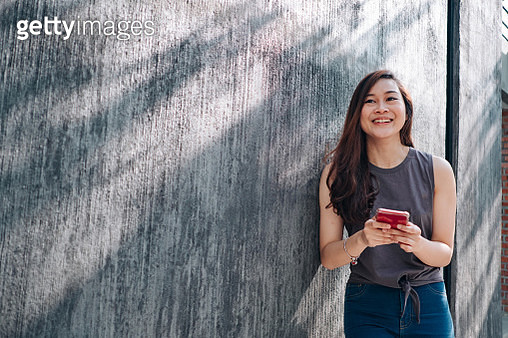Young Asian Women Playing Smartphone - gettyimageskorea