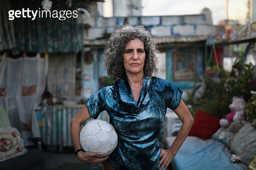 Portrait of woman with soccer ball - gettyimageskorea