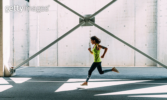 Sportswoman jogging outside - gettyimageskorea