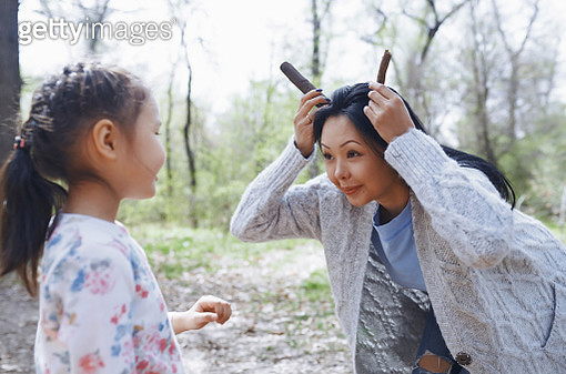Mother playing with little daughter in a park - gettyimageskorea