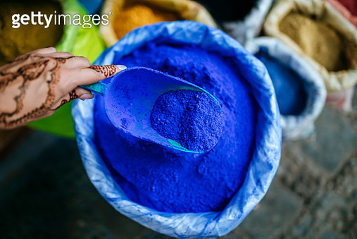 Morocco, Chefchaouen, womans hand painted with henna tattoo holding ladle with blue pigments - gettyimageskorea
