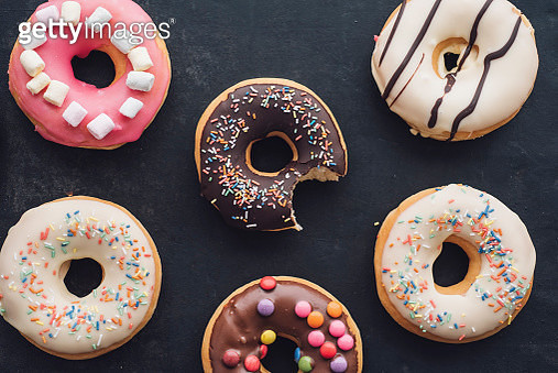Colorful doughnuts with different icings - gettyimageskorea