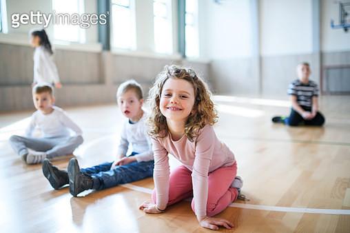 Small children doing sport on PE lesson. - gettyimageskorea