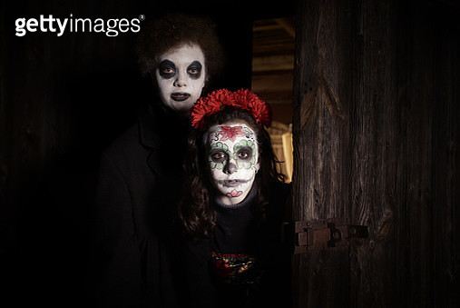 teenage girl and boy in spooky halloween costumes in old barn - gettyimageskorea