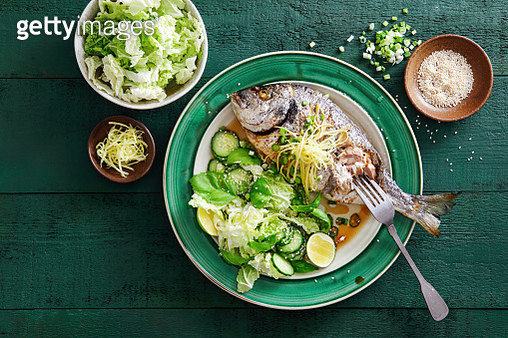 Grilled sea bream with vegetables, herbs, ginger, quinoa salad - gettyimageskorea