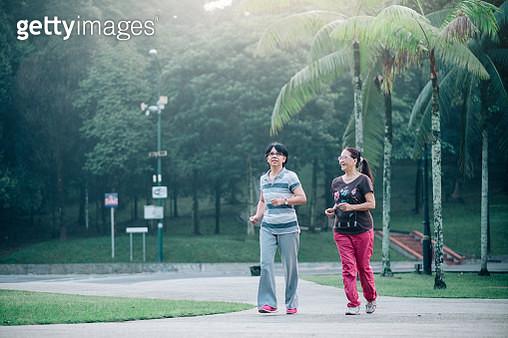 Two Lovely Senior Women Jogging Together - gettyimageskorea